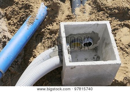 Corrugated Pipes For Electrical Cables And A Cockpit In Concrete In The Excavation