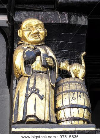 Monk making merry with a jug of ale