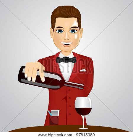 handsome waiter pouring wine into glass