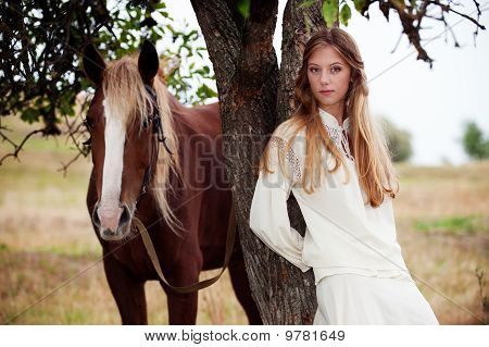 Pretty Woman With Brown Horse