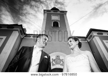 Newlyweds Posing In Front Of Lukavec Castle Bw