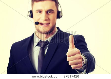 Handsome happy phone operator showing ok sign.
