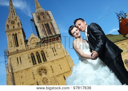 Bride And Groom In Front Of Cathedral