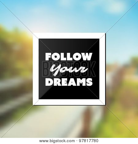 Follow Your Dreams - Inspirational Quote, Slogan, Saying - Success Concept Illustration with Label and Blurry Natural Wooden Pathway Image Background