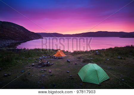 tent on wild beach at sunset light
