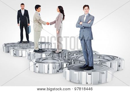 Business team against cogs and wheels