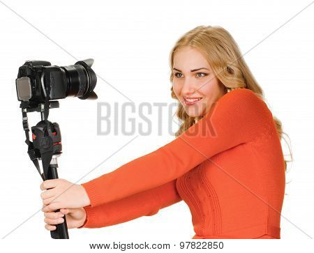 Beautiful young woman taking a selfie photo with photocamera