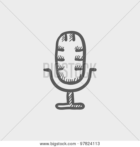 Retro microphone sketch icon for web and mobile. Hand drawn vector dark grey icon on light grey background.
