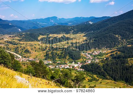 Aeral View Bulgarian Village In Rhodope. Mountains Landscape.