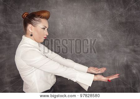 Woman Holding Something Heavy
