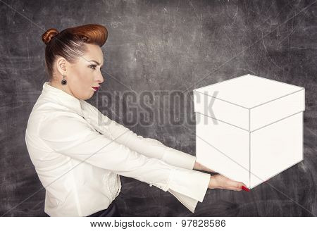 Woman Holding Heavy Box In Her Hands