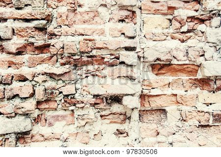Old grungy destroyed background of a red brick wall texture