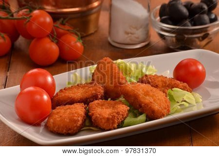 Breaded chicken nuggets dish.