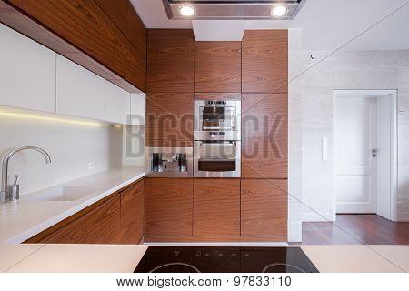 Spacious White And Brown Kitchen