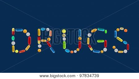The word Drugs made with pills on dark blue background