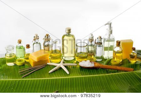 Spa set on banana leaf with bottle of oil