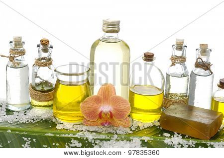 Spa set on banana leaf with pile of salt ,many oil