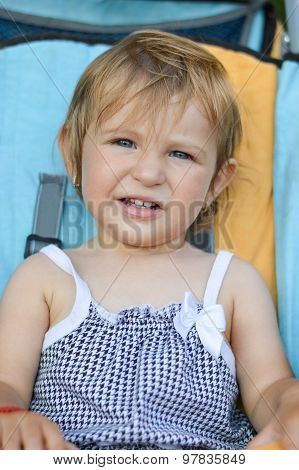 Portrait Of Adorable One Year Old Baby Girl Riding In Baby Carriage