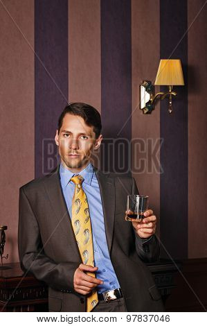 Businessman Holding A Glass Of Whiskey.