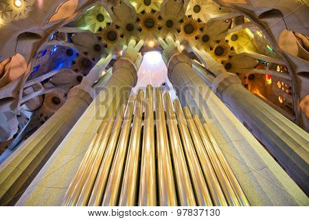BARCELONA, SPAIN - MAY 02: Organ pipes and ceiling, Sagrada Familia, Barceloni , Spain, a Roman Catholic church design by Antoni Gaudi to resemble branching trees. May 02, 2015 in Barcelona Spain