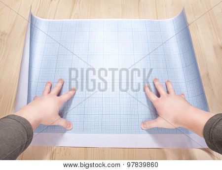 Hands Holding A Blank Of The Blueprint