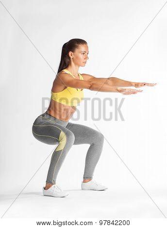 Hispanic Woman Doing Squats On White Background