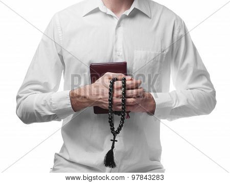 Male Prayer In White Shirt With Bible And Beads