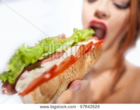 Beautiful Sexy Woman Eating Hot Dog