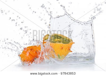 Fresh kiwano with water splashes