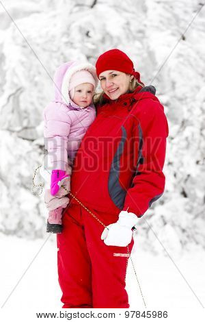 portrait of mother with little daughter in winter
