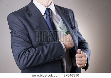 Businessman With Money In Studio. Corruption Concept