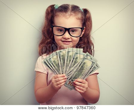 Happy Emotion Kid Girl In Glasses Holding Money In The Hand And Looking With Smile. Vintage Portrait