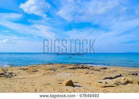 Lu Bagnu Rocky Shore On A Cloudy Day