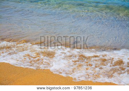 Wave By A Golden Foreshore In Sardinia