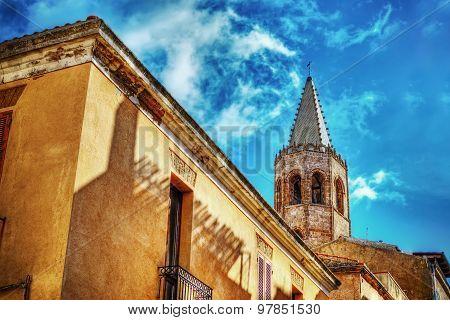 Duomo Steeple Under Clouds In Alghero