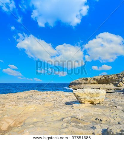 Rocks And Clouds In Porto Torres