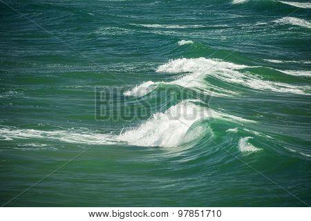 Sea Waves Splashing Through The Summer Day