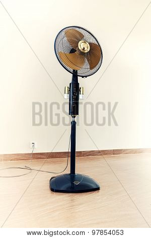 Large Modern Electric Fan In Empty Room