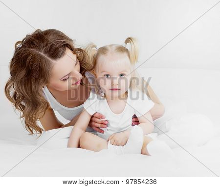 happy mother and her two year old daughter at home