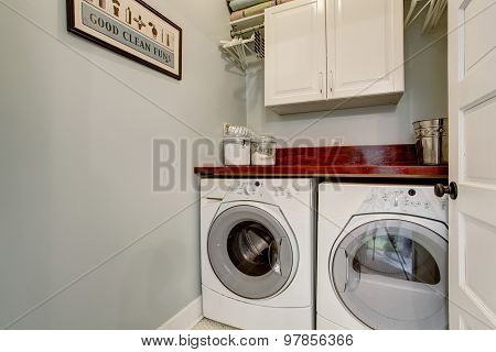 Small Laundry Room With Door And Washr Dryer Set.