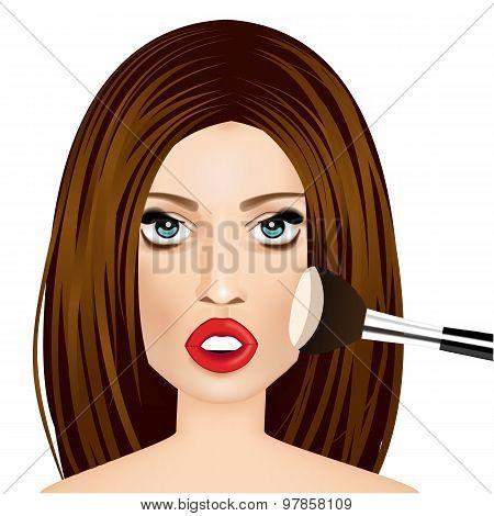 makeup artist applying powder brush to woman