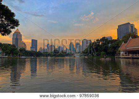 A splendid skyline view from Lumphini Park towards the Silom-Sathorn CBD at dusk