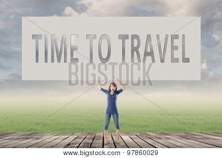 Time to travel, words on blank board hold by a young girl in the outdoor.