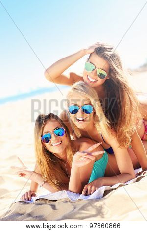 A picture of a group of women having fun on the beach
