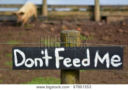 Do Not Feed Me Sign On Pig Pen