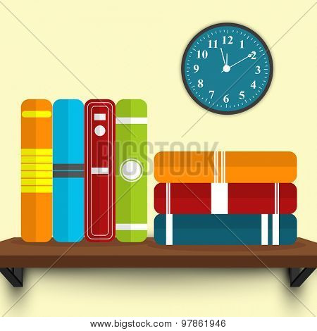 Row and stack of colorful books on shelf shelf.