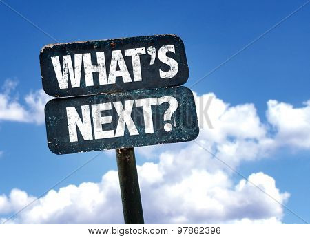 Whats Next? sign with clouds on background