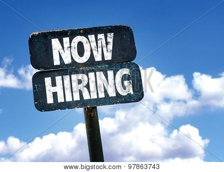 Now Hiring sign with clouds on background