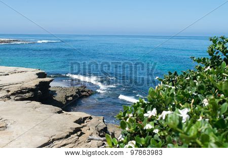 Ocean waves at shoreline from cliffs above