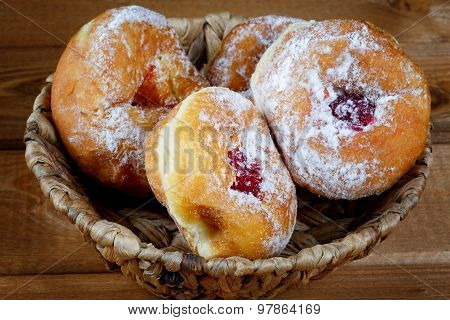 Donuts With Jam In A Wicker Basket